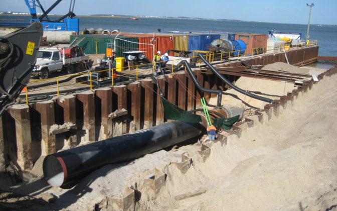 Pipe Intalled Beneath Sand Next To Dock